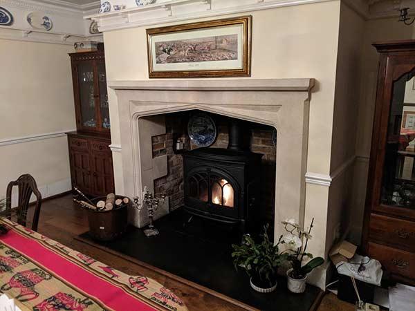 Limestone fireplace mantel install