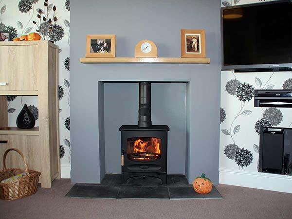 Fireplace with a mantel shelf