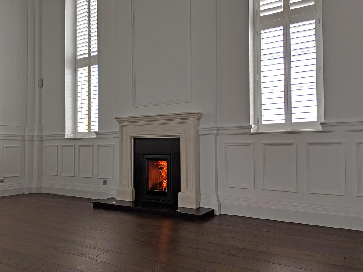 Stovax elise stove in limestone fireplace