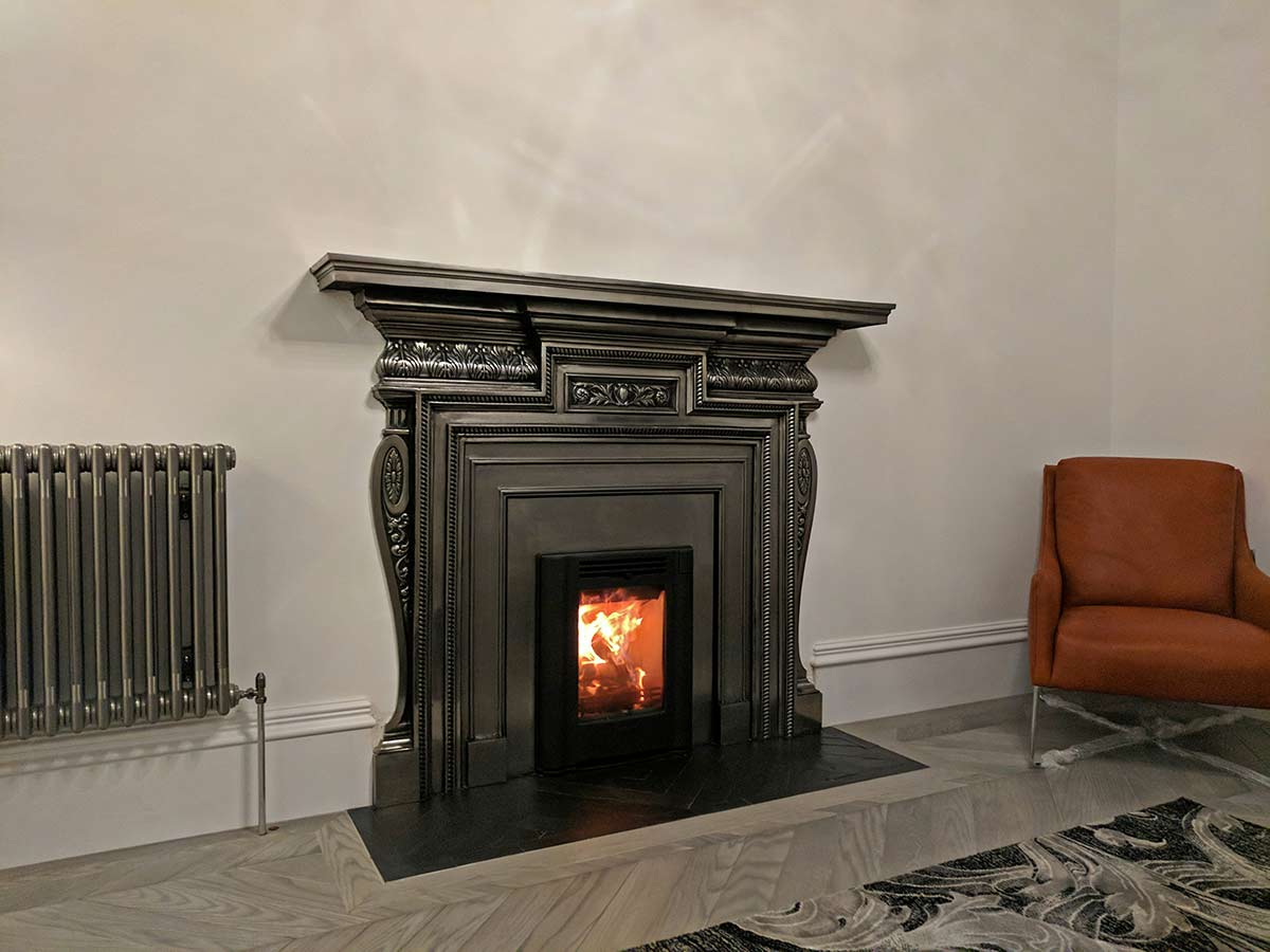 Knightsbridge mantel with wood stove