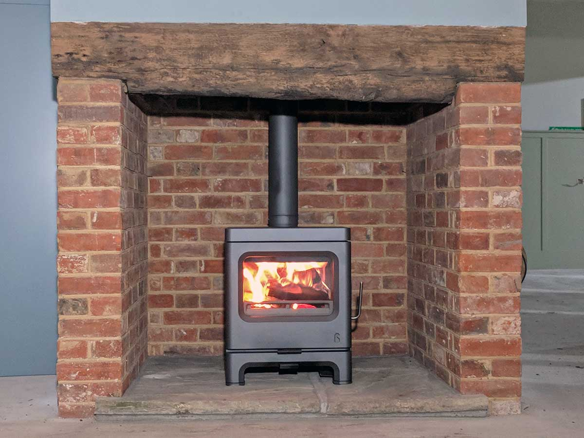 Ecodesign stove in a brick fireplace