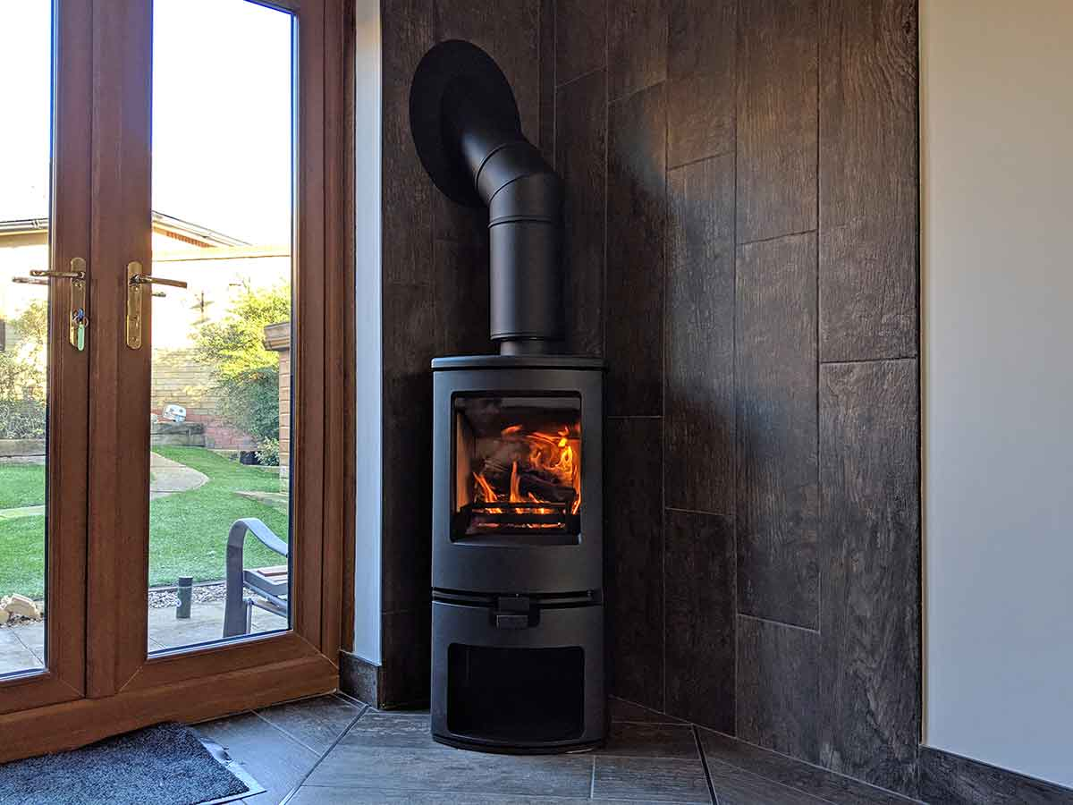 Arc 5 stove in bespoke tiled fireplace