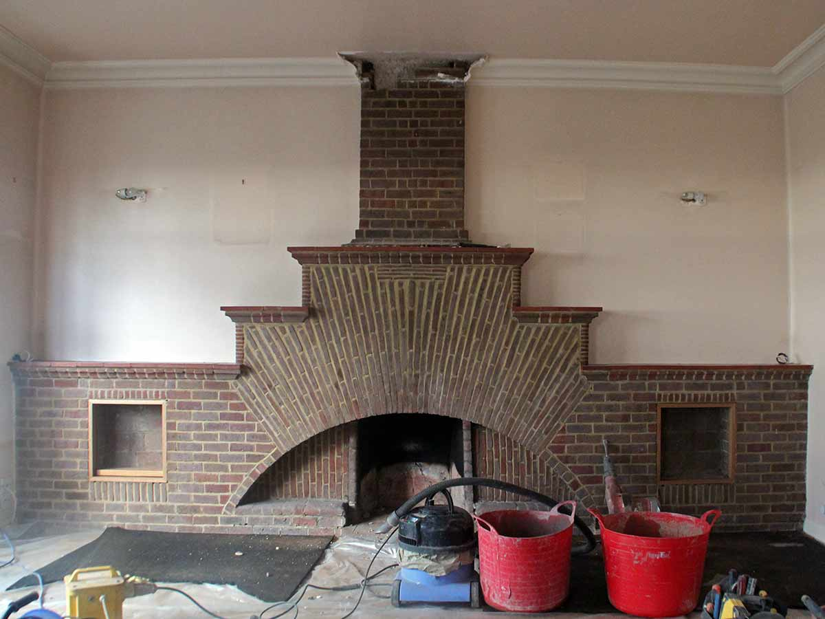 Old brick fireplace before removal