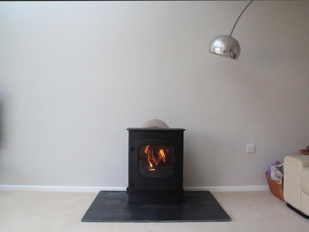 Freestanding boiler stove on slate hearth