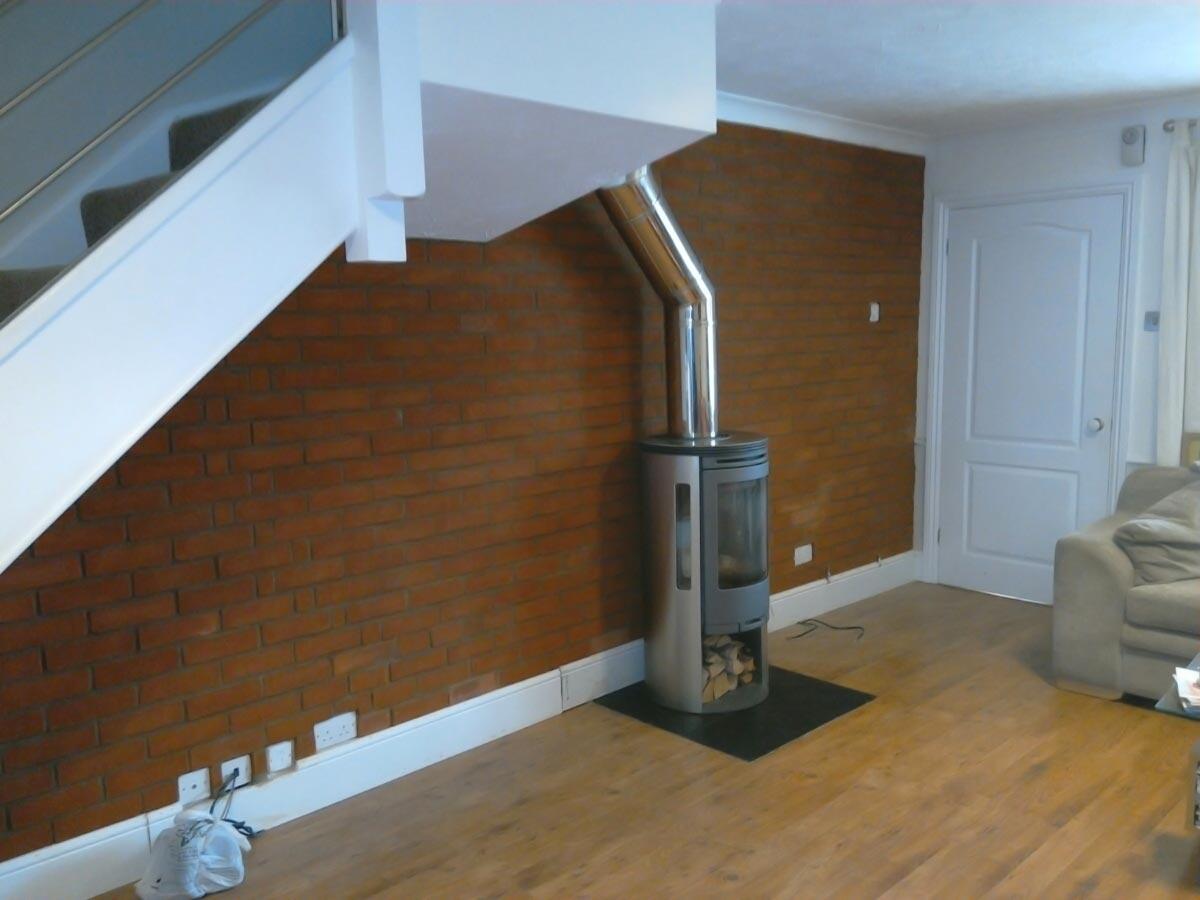 Contura 556 with brick slip wall fireplace