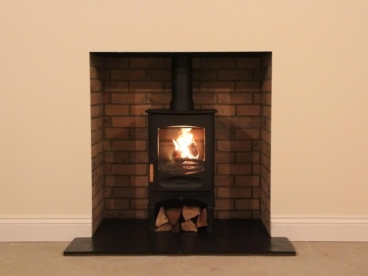 Brick fireplace with C four stove