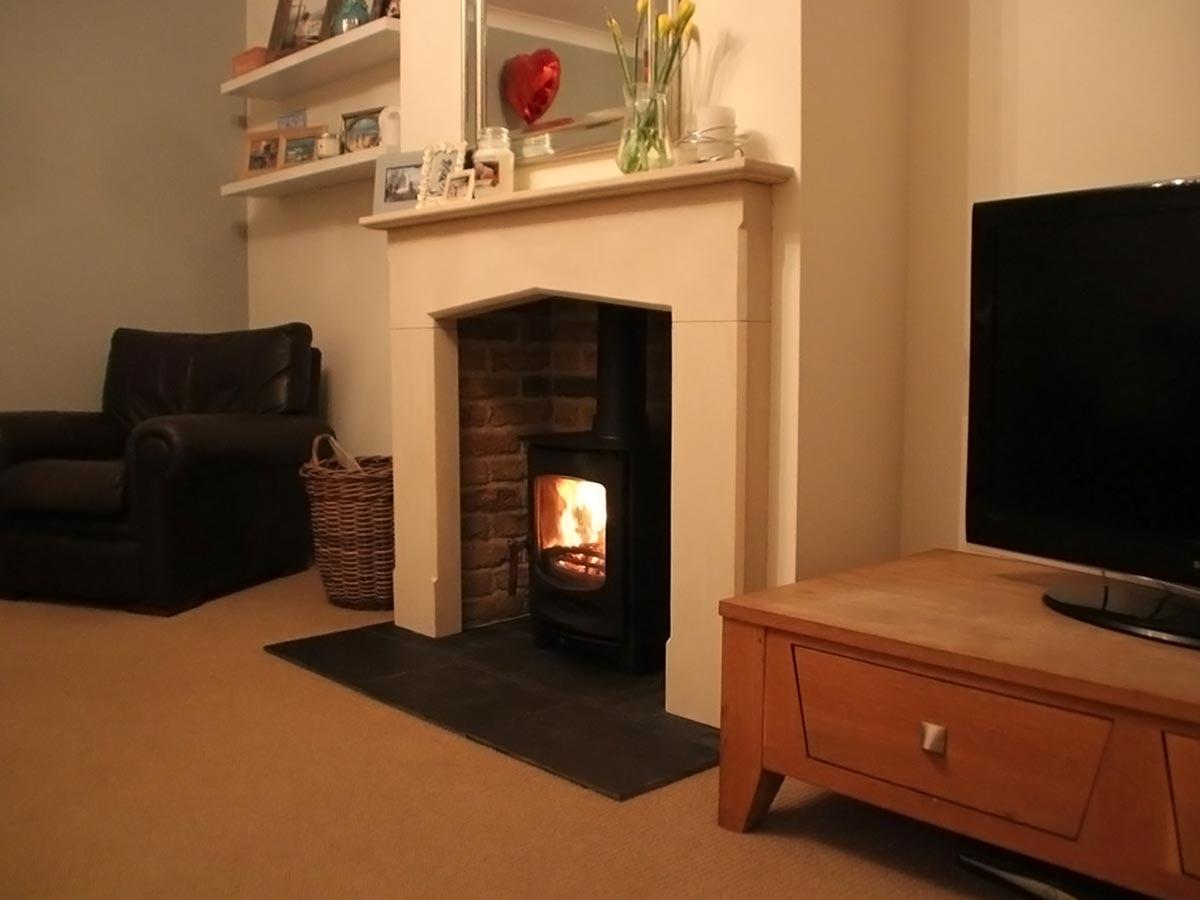 Limestone mantel with brick slip fireplace chamber