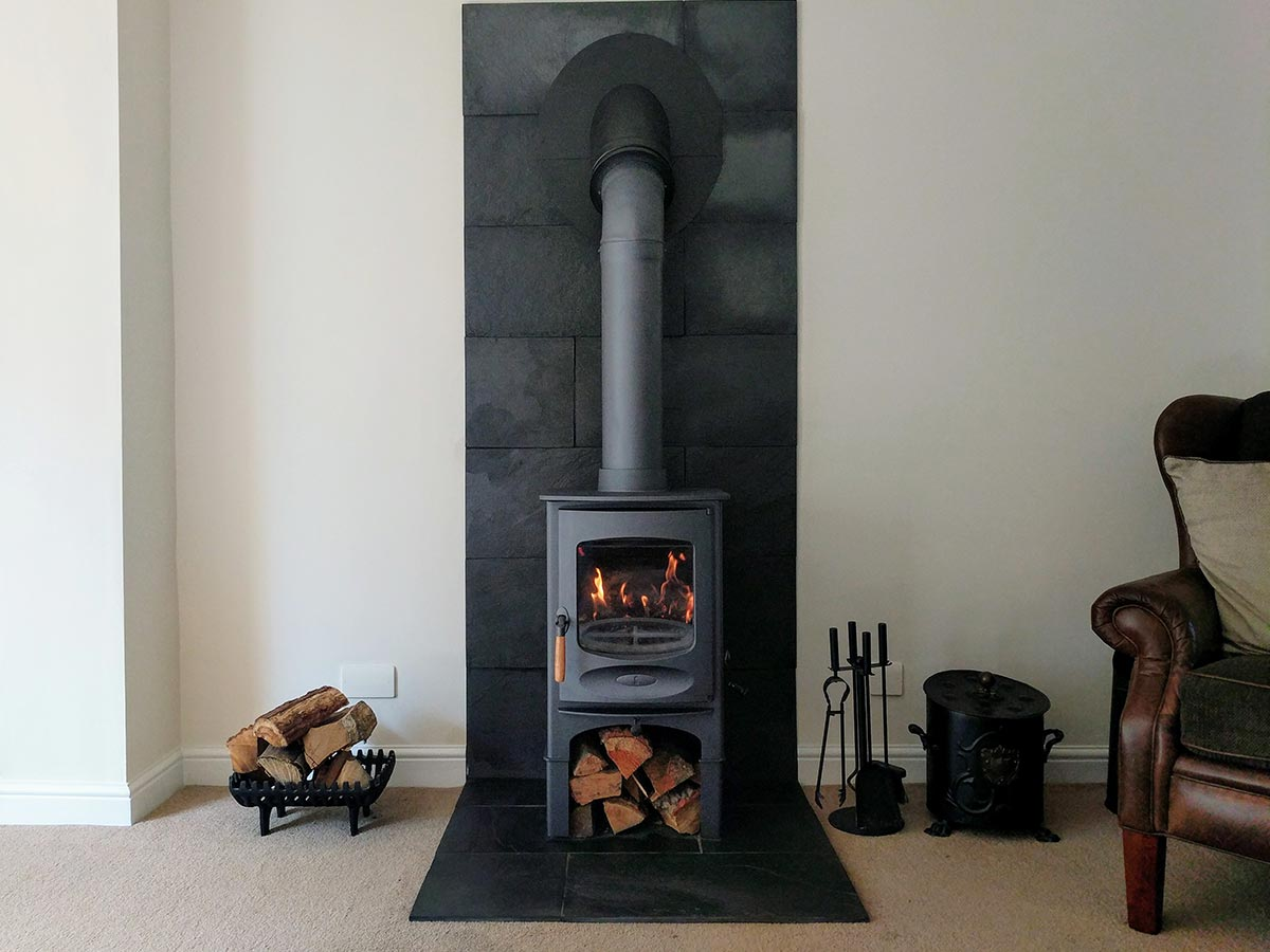 blue wood stove with slate fireplace