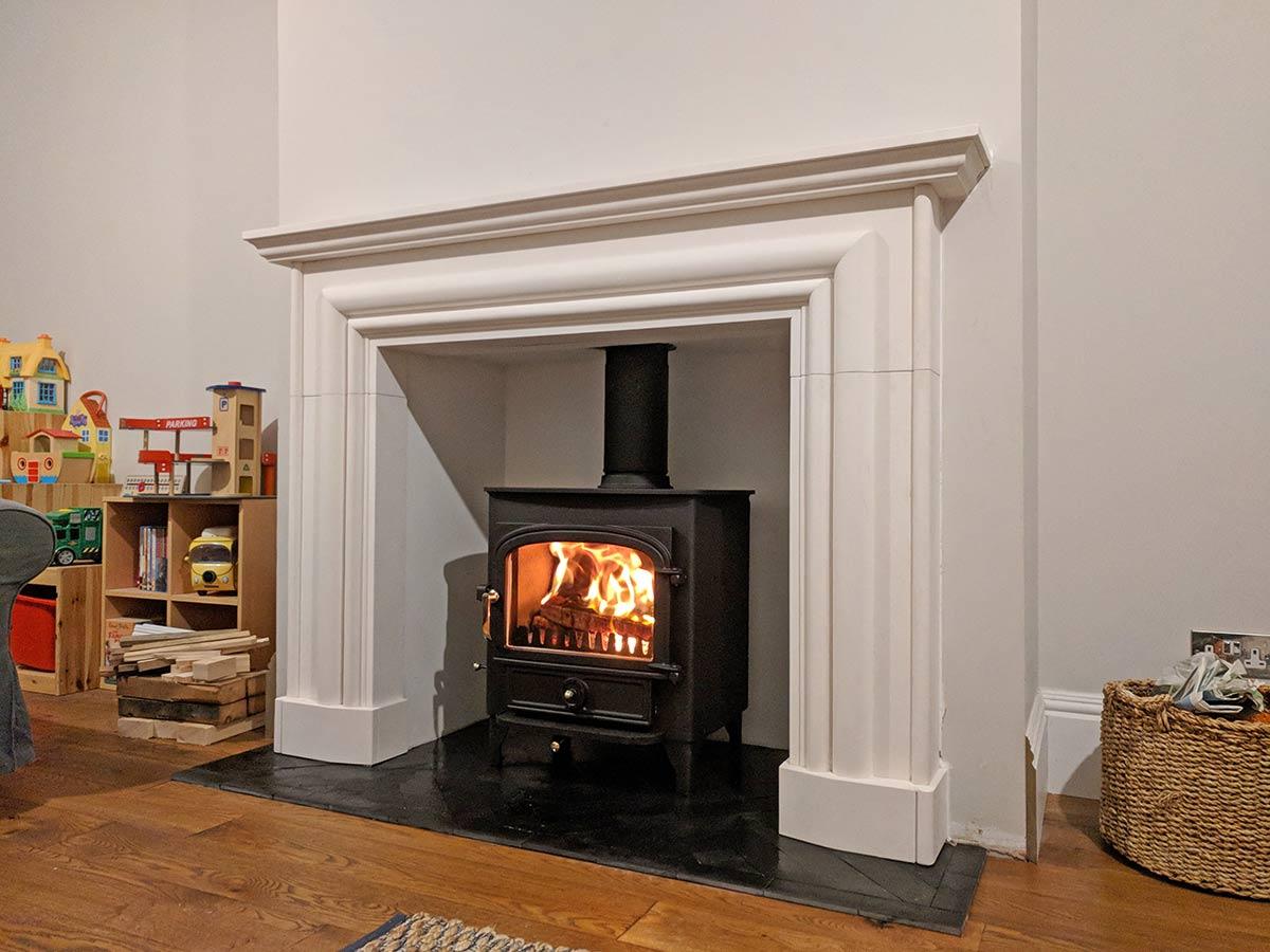 limestone bespoke mantel with stove