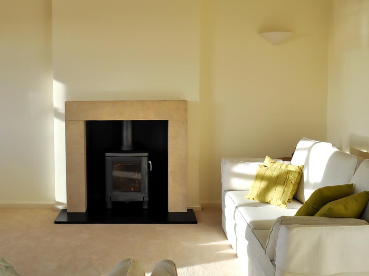 Limestone fireplace mantel with Contura 51L
