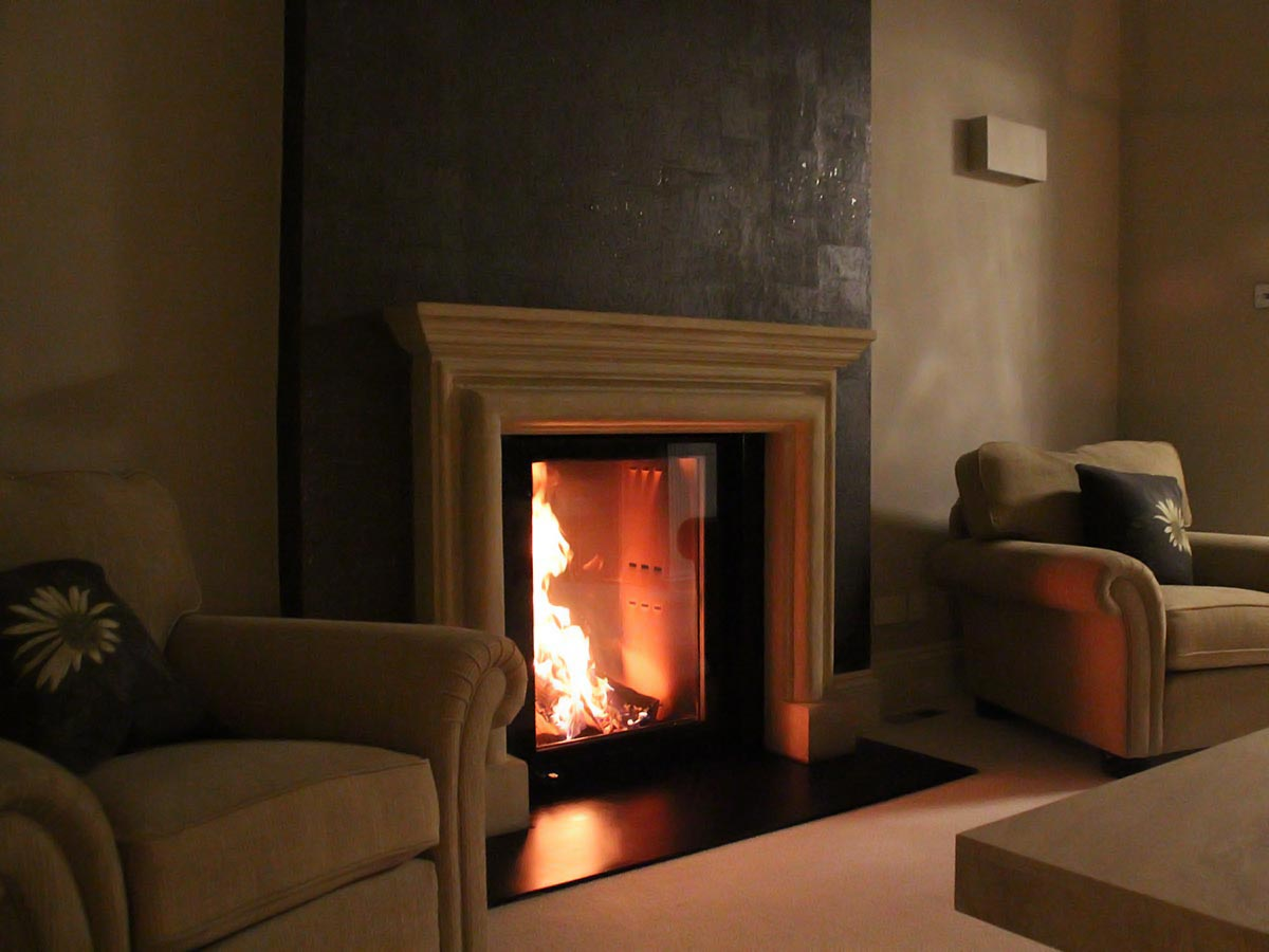 Fondis stove with limestone mantel