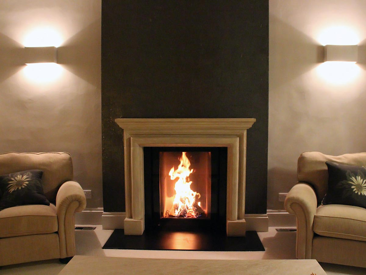 Traditional fireplace with modern stove