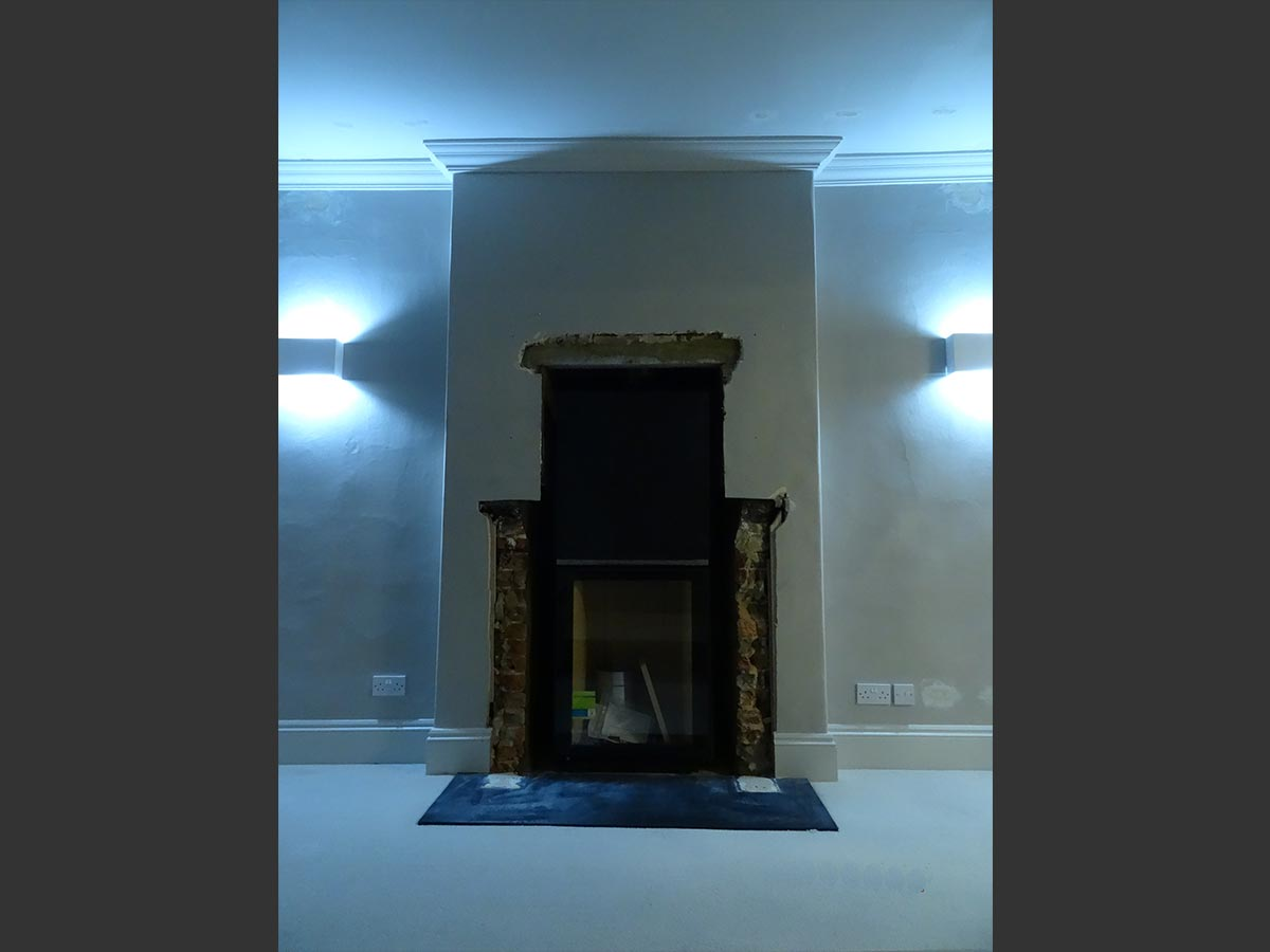 Fondis stove installed into chimney breast