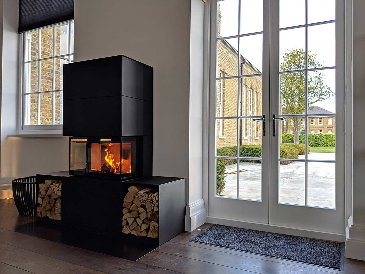 wood stove with log storage