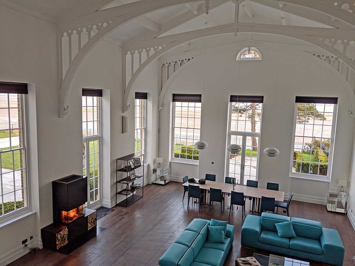 large Victorian room with wood stove