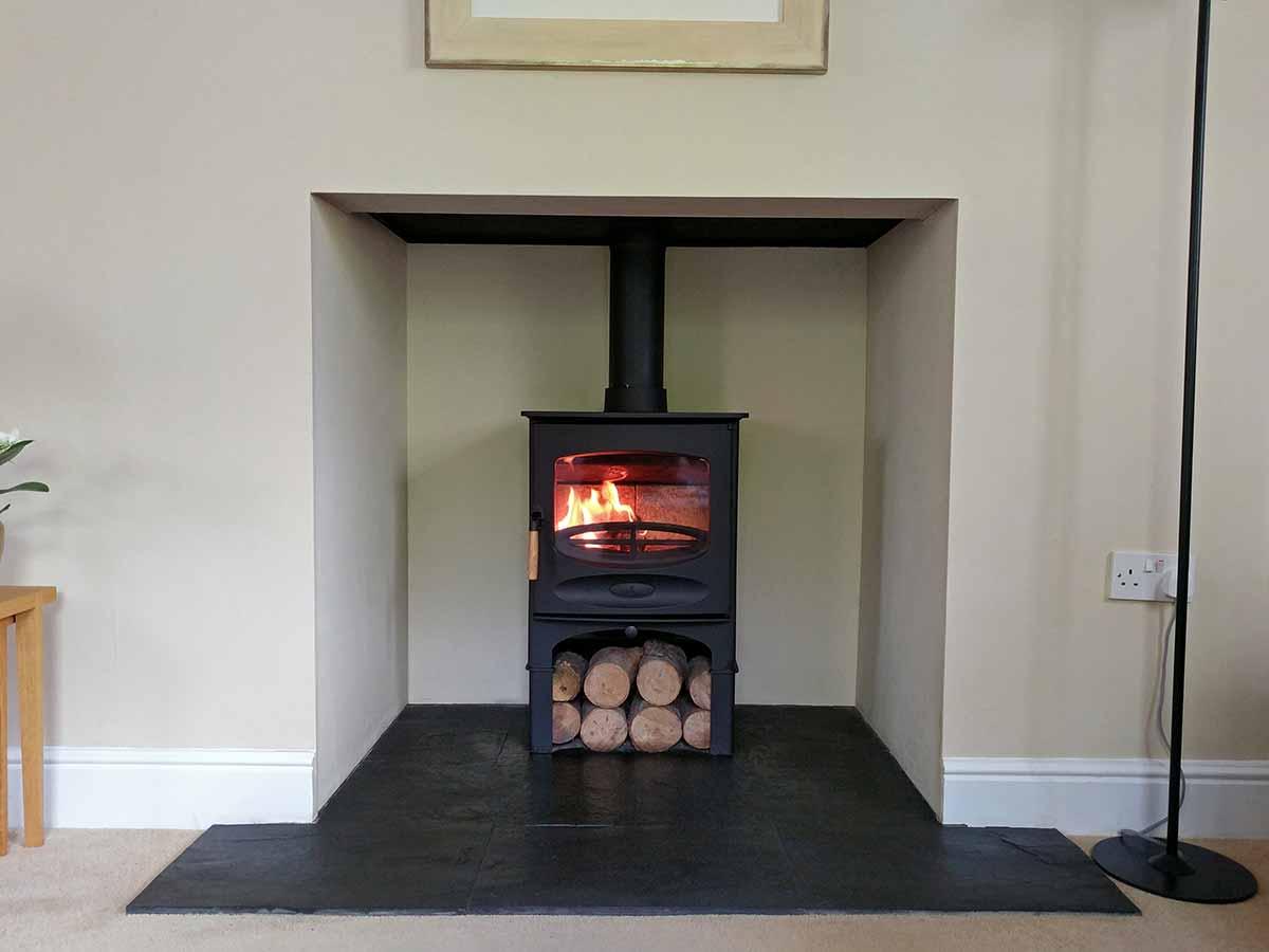 Bespoke fireplace with plain fireplace chamber
