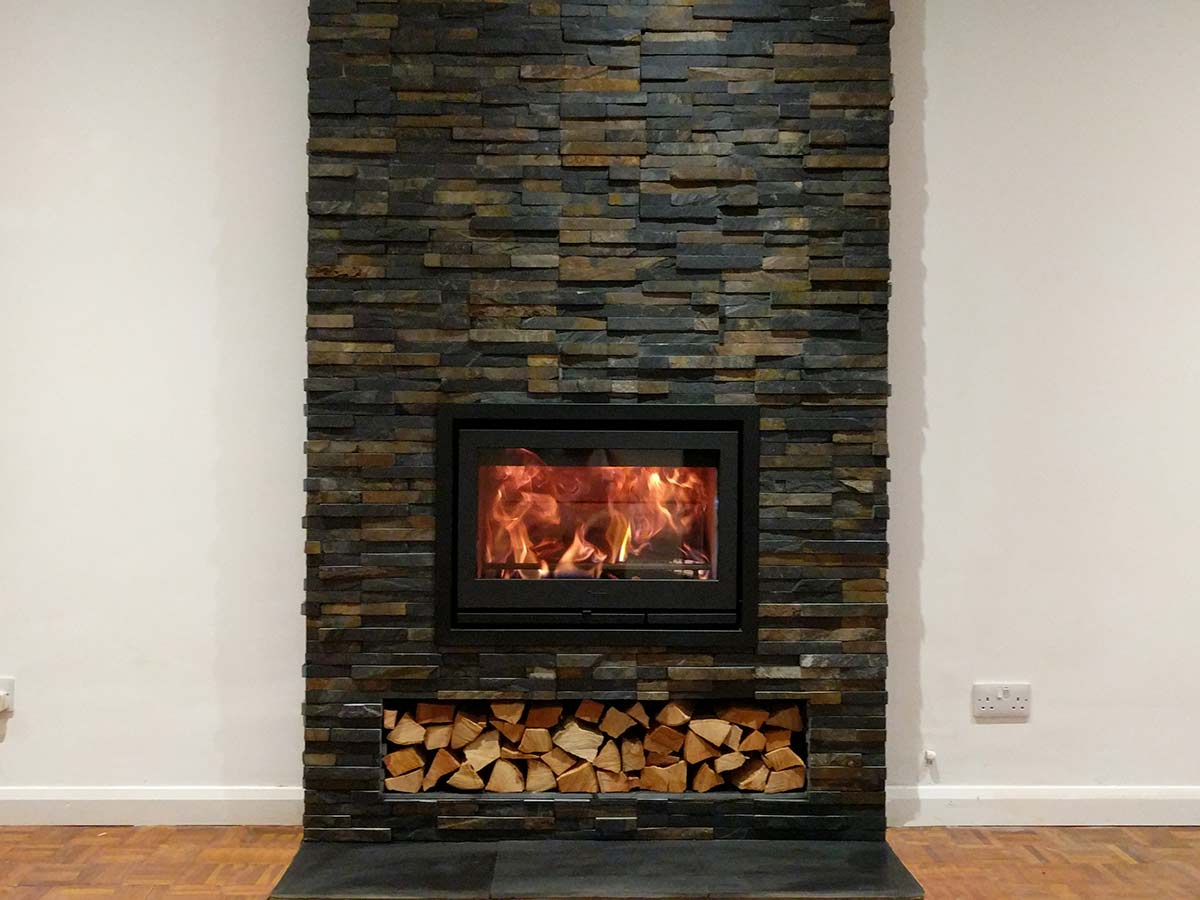 Split face slate tiled fireplace