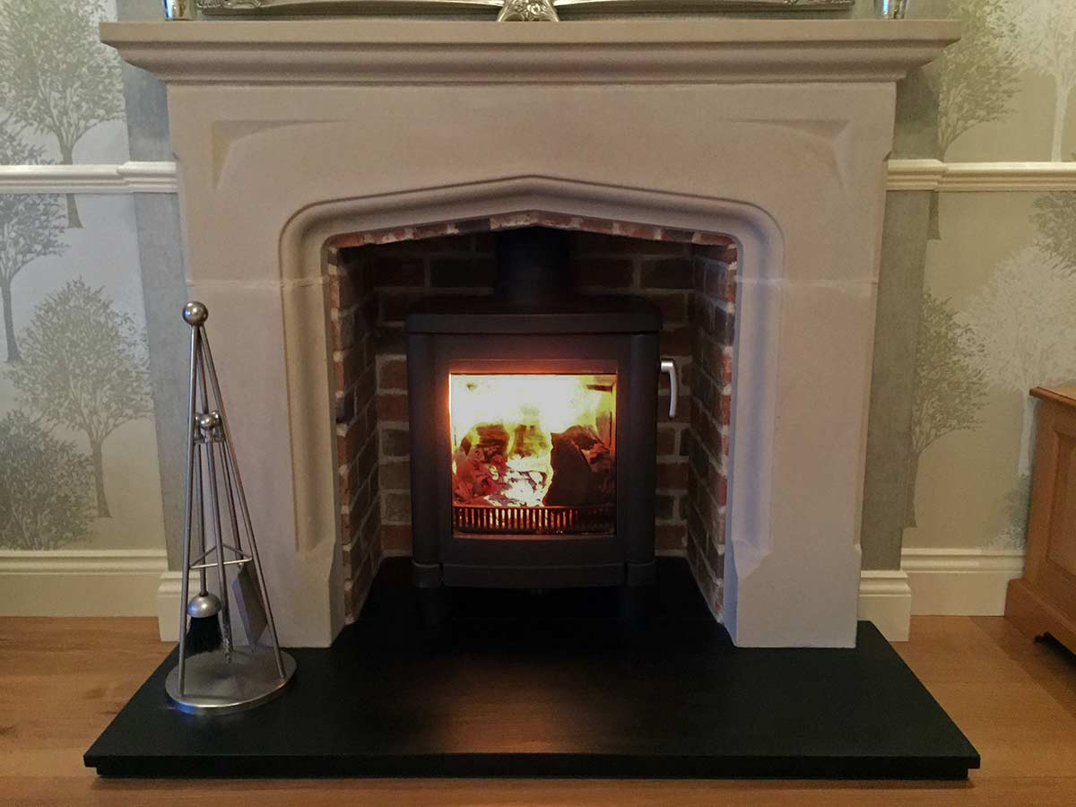 Limestone fireplace mantel with contura 51L