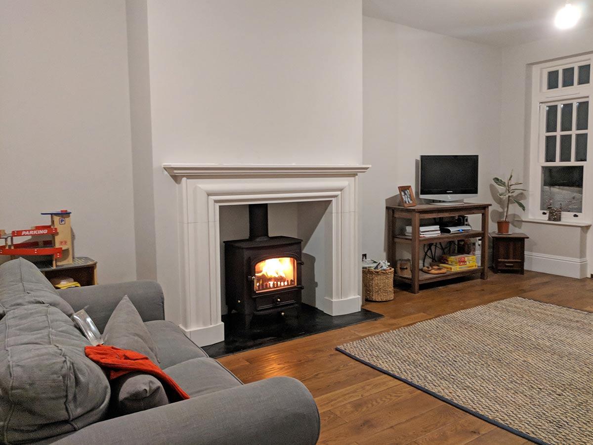 bespoke fireplace with stone mantel