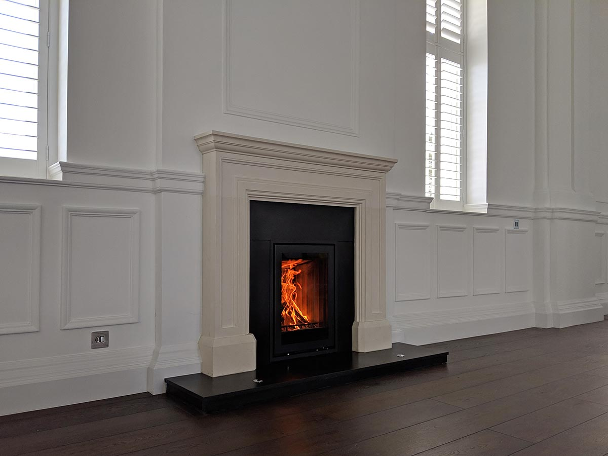Stovax 540T with limestone fireplace