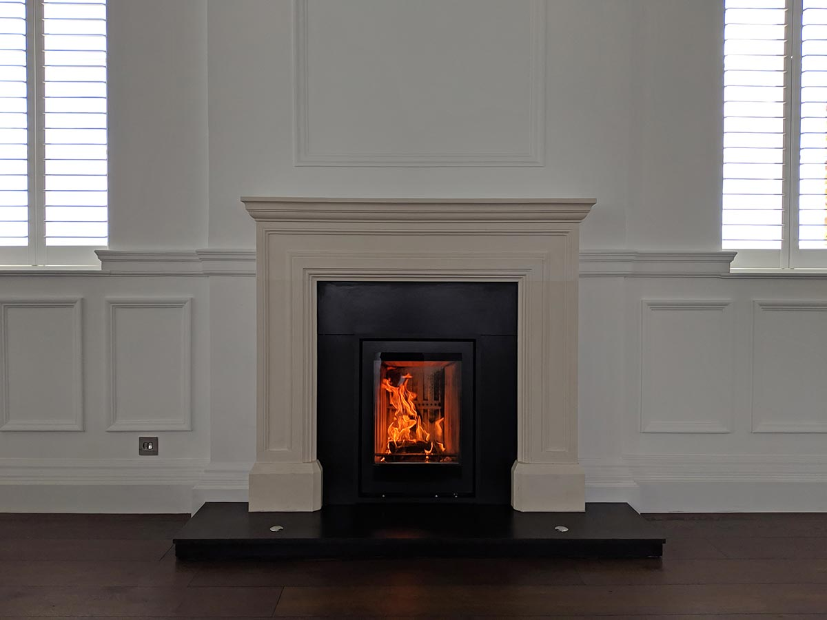 Limestone fireplace with Stovax Elise