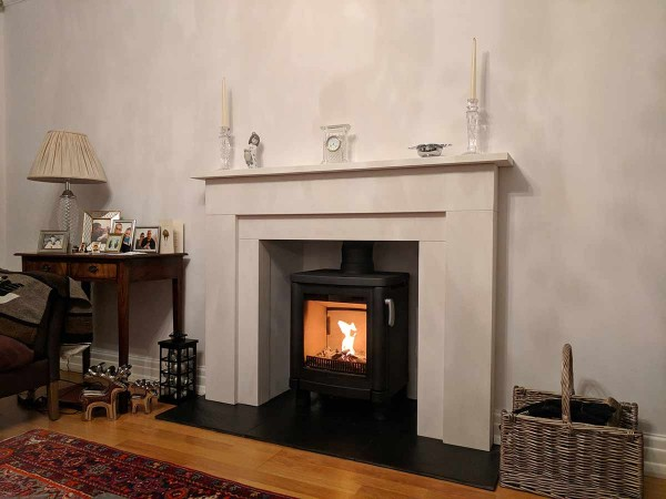 log stove in fireplace