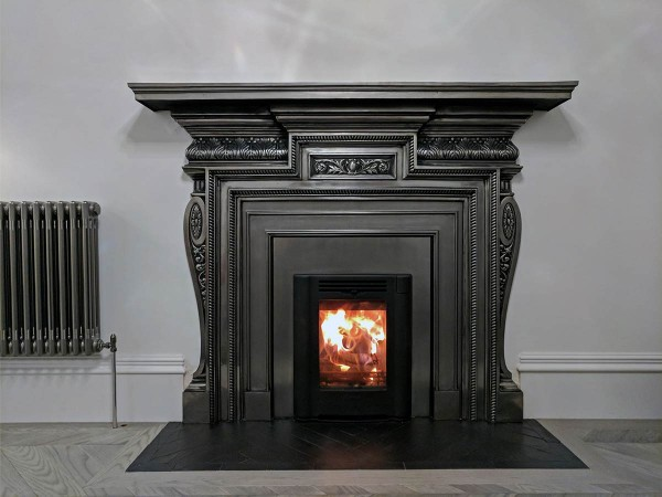Cast iron mantel and insert stove