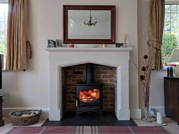 A fireplace with a stone mantel
