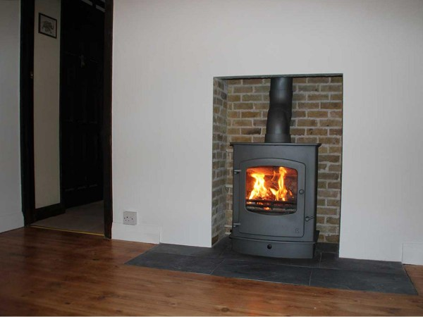 wood burning boiler stove in fireplace