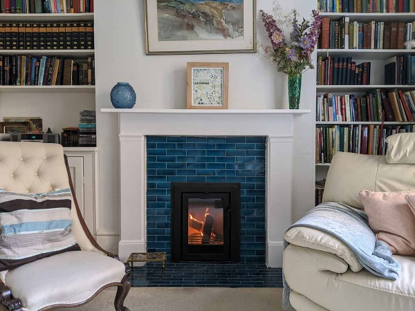 Renovated antique fireplace with wood stove