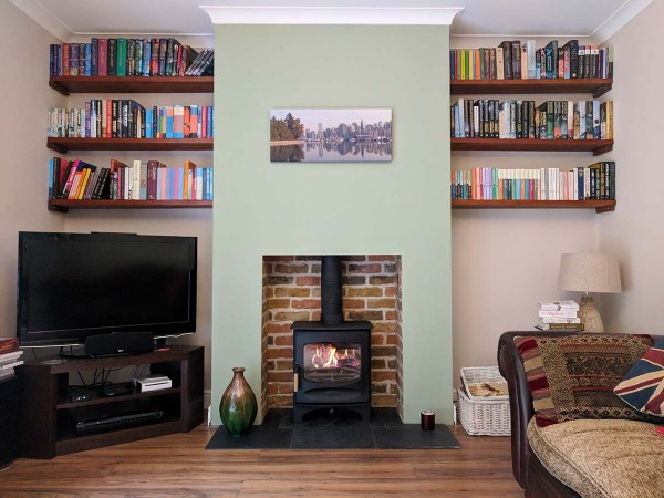 Charnwood C-Five in a brick slip fireplace chamber