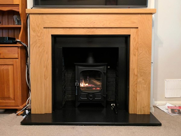 bespoke fireplace with wooden mantel