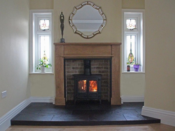 Bespoke oak fireplace mantel with brick chamber
