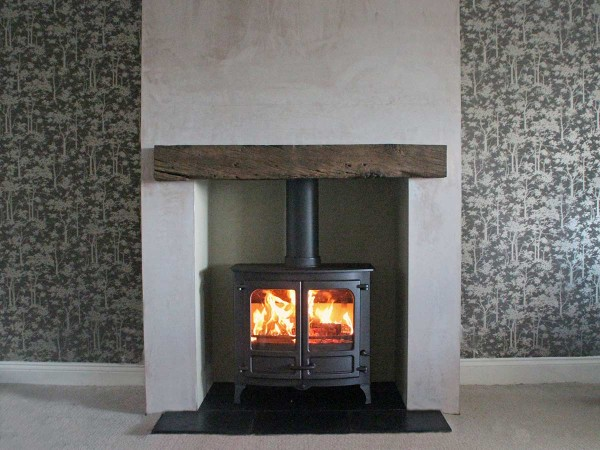 Oak beam fireplace with a charnwood island 3 stove
