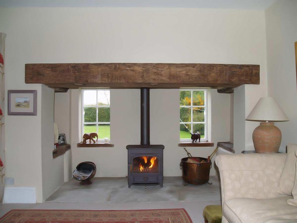 Renovated Inglenook fireplace with sandstone slab hearth