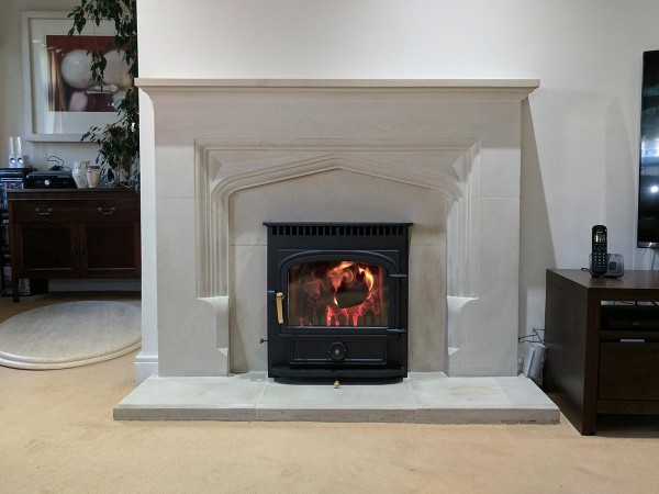 Insert stove in a limestone fireplace