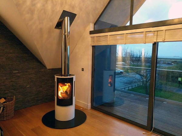 Contura 556G wood stove on round granite hearth