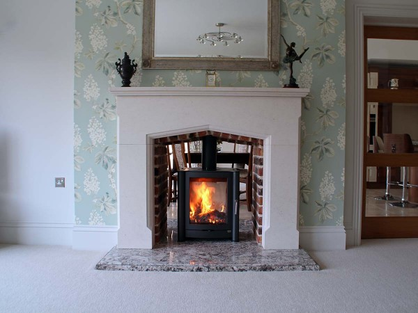 Double sided stove in stone mantel