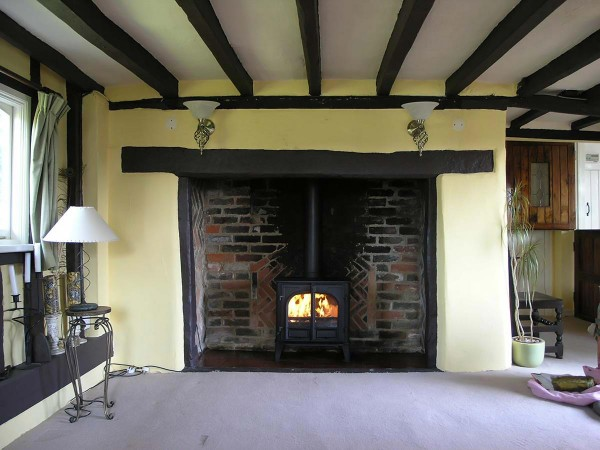 inglenook brick fireplace with stove