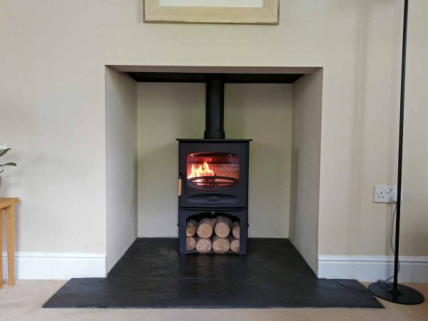 Bespoke fireplace with plain fireplace chamber