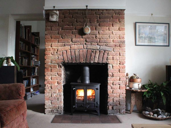 renovated brick fireplace with Charnwood island 1
