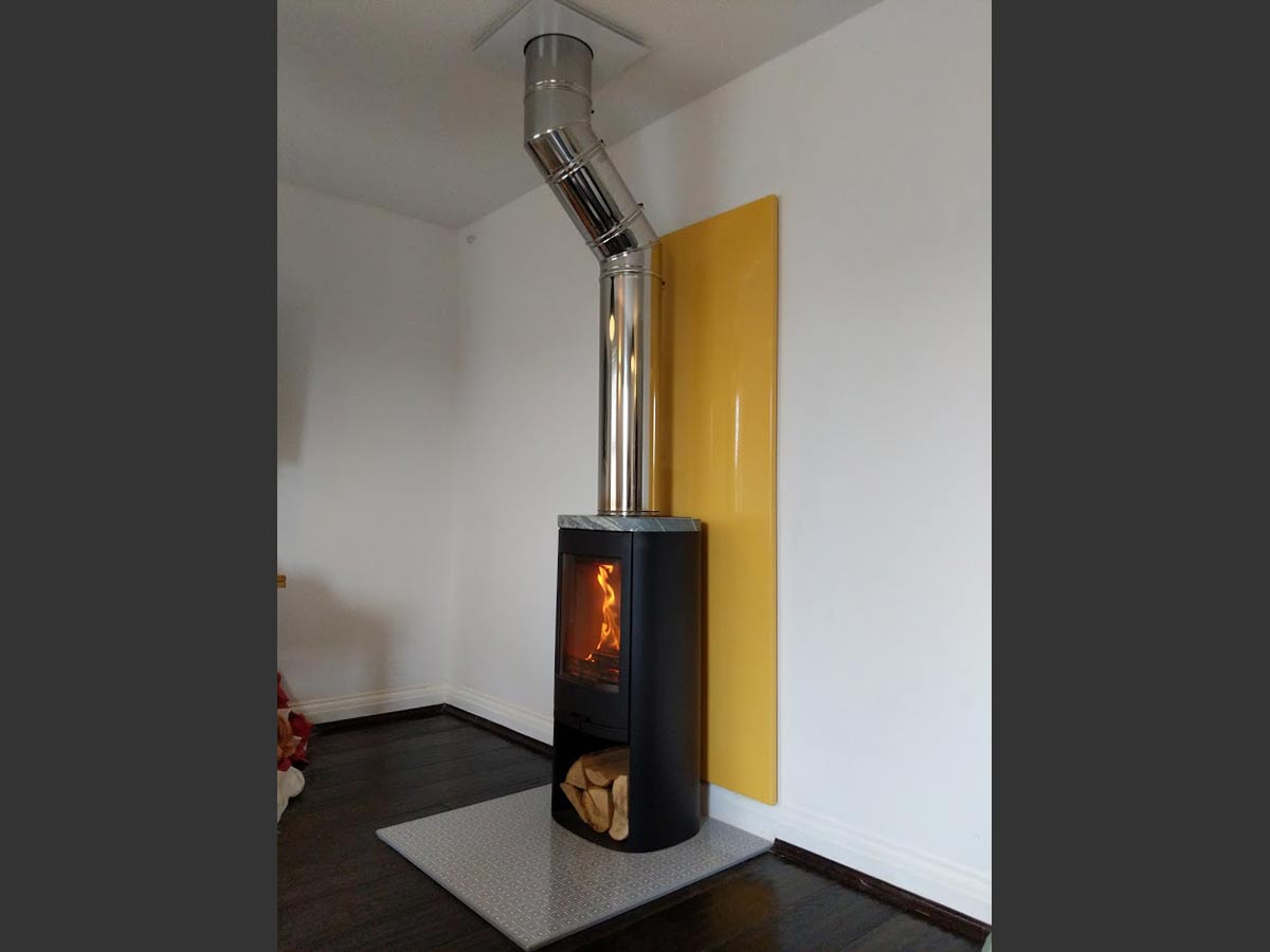 fireplace with yellow vlaze panel